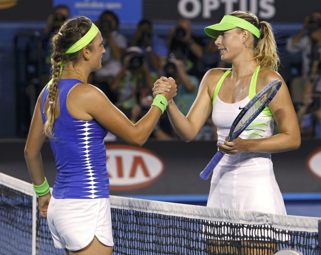 Victoria Azarenka of Belarus (L) shakes hands with Maria Sharapova of Russia after their women's singles final match at the Australian Open tennis tournament in Melbourne January 28, 2012. REUTERS/Vivek Prakash (AUSTRALIA - Tags: SPORT TENNIS)